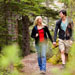 Couple walking along a forest trail