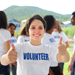 Young lady volunteer showing two thumbs up