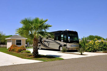 Motorhome on RV site at Bentsen Palm Village TX