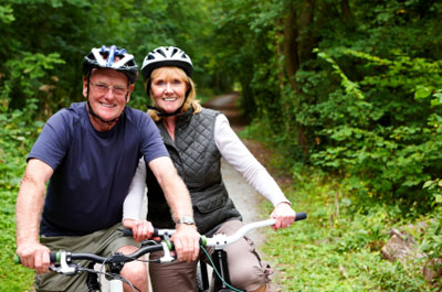 Mature couple on their bikes in the country