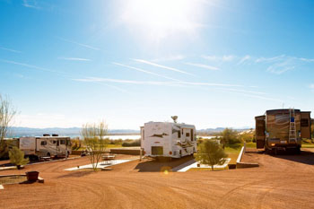Motorcoaches parked at RV sites at The Motorcoach Resort at the Refuge Golf and Country Club