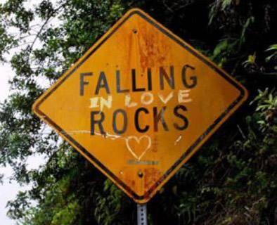 "Falling Rocks road sign that has been changed to ""Falling in Love Rocks """