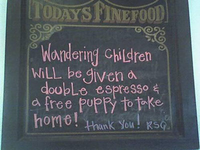 "Sign that reads ""Wandering Children will be given a double espresso and a free puppy to take home.  Thank you!"""