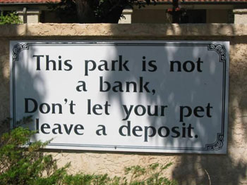 "Campground sign that reads ""This park is not a bank. Don't let your pet leave a deposit."""
