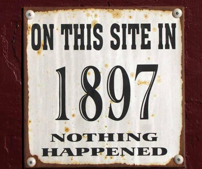"Campground sign that reads ""On This Site in 1897 nothing happened"""