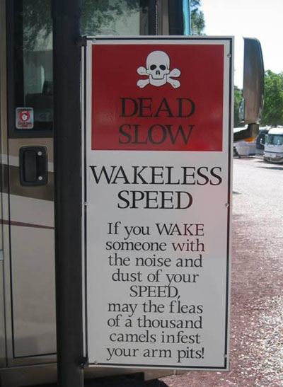 "Campground sign that reads ""Dead slow, wakeless speed. If you wake someone with the noise and dust of your speed, may the fleas of a thousand camels infest your arm pits"""