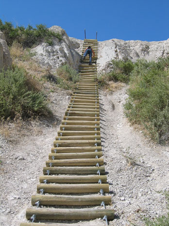 Climbing the ladder on Notch Trail, Badlands National Park