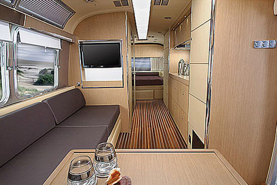 Interior of Airstream Land Yacht, front to back showing living area and bedroom