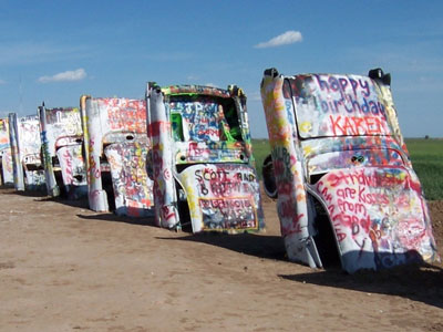 Half buried cars at Cadillac Ranch Amarillo TX