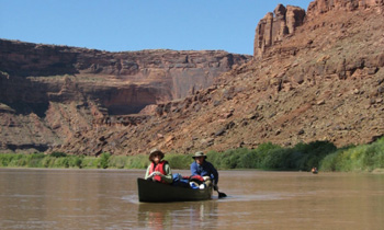 Woman rafting in the Desolation Canyon, Green River