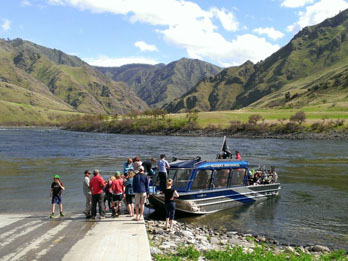Group of people getting on a jetboat at Pittsburg Landing on the Snake River, ID