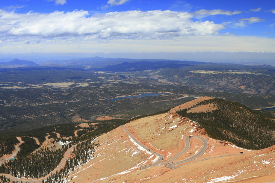 View from Devil's Playground on Pikes Peak looking at the winding Pikes Peak Highway with scenic view of Colorado behind