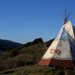 Tipi on top of a hill
