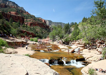 Families swimming and playing in Sliding Rock State Park, Sedona, AZ