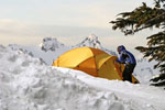 Man entering a tent in the snow