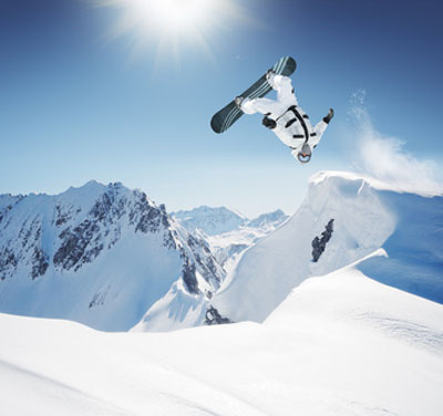 Snowboarder doing a flip