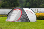 Self erecting tent pitched in front of a lake