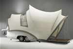 Pop-up camper that looks like the Sydney Opera House on wheels