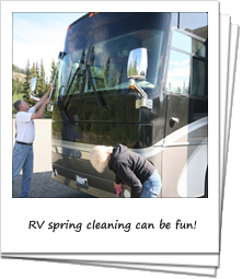 Couple spring cleaning an RV