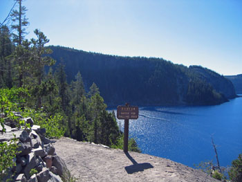 "View of Crater Lake from Cleetwood Trail and a ""Danger Watch for Falling Rock"" trail sign"