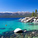Beautiful blue Lake Tahoe with mountains framing the horizon