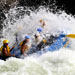 Big splash of water covers whitewater rafters
