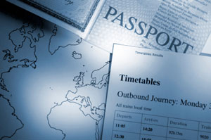 Passport, world map and timetable
