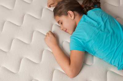 Young girl resting on a mattress