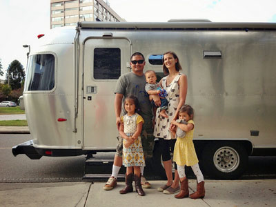 The Lin Family in front of Mali Mish; their Airstream trailer